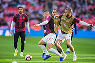 Ross Barkley (England) & Eric Dier (England) warming up ahead of the UEFA Nations League match between England and Croatia at Wembley Stadium, London, England on 18 November 2018.