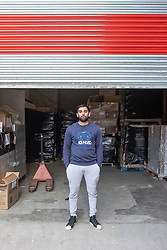 """© Licensed to London News Pictures. 07/05/2020. Salford, UK. Manager at Puro Medico SALAIMAAN MAJID (28) stands in front of the newly repaired shutters outside the warehouse from where the PPE was stacked up when it was stolen . £166,000 (one hundred and sixty six thousand pounds) worth of protective masks , which were destined for the NHS and care homes , have been stolen from a warehouse overnight (6th-7th May 2020) in what Greater Manchester Police are describing as a """" targeted burglary """" . Thieves cut the shutters at the loading bay of Puro Medico - which specialises in importing PPE such as masks from China and hand sanitiser from Poland - and stole several pallets of stock , which was loaded on to vans over a two hour period . Photo credit: Joel Goodman/LNP"""