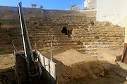 Roman amphitheatre site viewed through observation window, Cadiz, Spain