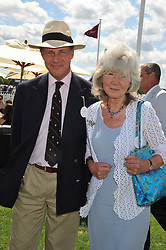 JILLY COOPER and TIM BUXTON at the 27th annual Cartier International Polo Day featuring the 100th Coronation Cup between England and Brazil held at Guards Polo Club, Windsor Great Park, Berkshire on 24th July 2011.