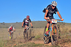 ROBERTSON, SOUTH AFRICA - MARCH 20: Samuele Porro ahead of Jaroslav Kulhavy and Daniel Geismeyr during stage two's 110km from Robertson on March 20, 2018 in Cape Town, South Africa. Mountain bikers from across South Africa and internationally gather to compete in the 2018 ABSA Cape Epic, racing 8 days and 658km across the Western Cape with an accumulated 13 530m of climbing ascent, often referred to as the 'untamed race' the Cape Epic is said to be the toughest mountain bike event in the world. (Photo by Dino Lloyd)