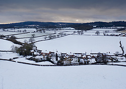 © Licensed to London News Pictures. 24/01/2021. Brockham, UK. Snow blankets fields near the village of Brockham in Surrey. A band of snow is crossing the south east this morning as temperature remain just above freezing. Photo credit: Peter Macdiarmid/LNP