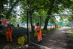 Denham, UK. 13 July, 2020. HS2 workers block a public footpath in Denham Country Park to facilitate tree felling work for the high-speed rail link. Environmental activists from HS2 Rebellion have been seeking to hinder or prevent the construction of the £106bn rail link, which will remain a net contributor to CO2 emissions during its projected 120-year lifetime.