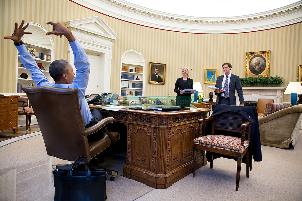 President Barack Obama gestures as he meets with Anita  Breckenridge, Deputy Chief of Staff for Operations and Chase Cushman, Director of Scheduling and Advance, in the Oval Office, April 17, 2015. (Official White House Photo by Pete Souza)<br /> <br /> This official White House photograph is being made available only for publication by news organizations and/or for personal use printing by the subject(s) of the photograph. The photograph may not be manipulated in any way and may not be used in commercial or political materials, advertisements, emails, products, promotions that in any way suggests approval or endorsement of the President, the First Family, or the White House.