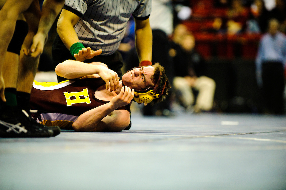 (staff photo by Matt Roth)..Hereford's Steve Sparks was pinned in 3:57 by Chesapeake's Jordan Tolbert during the 130 weight 3A/4A state wrestling championships semi-final match at the University of Maryland Cole Field House Saturday, March 6, 2010.