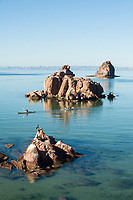 Young women kayaking on Isla Espiritu Santo in the Sea of Cortez, Mexico.