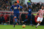 Chris Smalling of Manchester Utd in action.Premier league match, Stoke City v Manchester Utd at the Bet365 Stadium in Stoke on Trent, Staffs on Saturday 21st January 2017.<br /> pic by Andrew Orchard, Andrew Orchard sports photography.