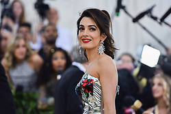 Amal Clooney walking the red carpet at The Metropolitan Museum of Art Costume Institute Benefit celebrating the opening of Heavenly Bodies : Fashion and the Catholic Imagination held at The Metropolitan Museum of Art  in New York, NY, on May 7, 2018. (Photo by Anthony Behar/Sipa USA)