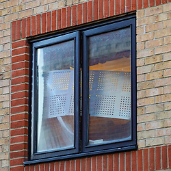 Despite protective screens, squatters appear to have moved in to the building on Globe Road in Stepney, East London where a man believed to be in his 20s or 30s was fatally stabbed on Monday 25th February, London. London, February 26 2019.