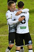 Football - 2020 / 2021 Sky Bet Championship - Swansea City vs Barnsley - Liberty Stadium<br /> <br /> Jake Bidwell of Swansea celebrates scoring his team's second goalMatt Grimes of Swansea<br /> <br /> COLORSPORT/WINSTON BYNORTH