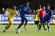 AFC Wimbledon midfielder Liam Trotter (14) chasing down Oxford United midfielder Ricky Holmes (12) during the EFL Sky Bet League 1 match between AFC Wimbledon and Oxford United at the Cherry Red Records Stadium, Kingston, England on 29 September 2018.