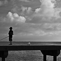 Fare, Huahine, French Polynesia, sunset, boy fishing on pier