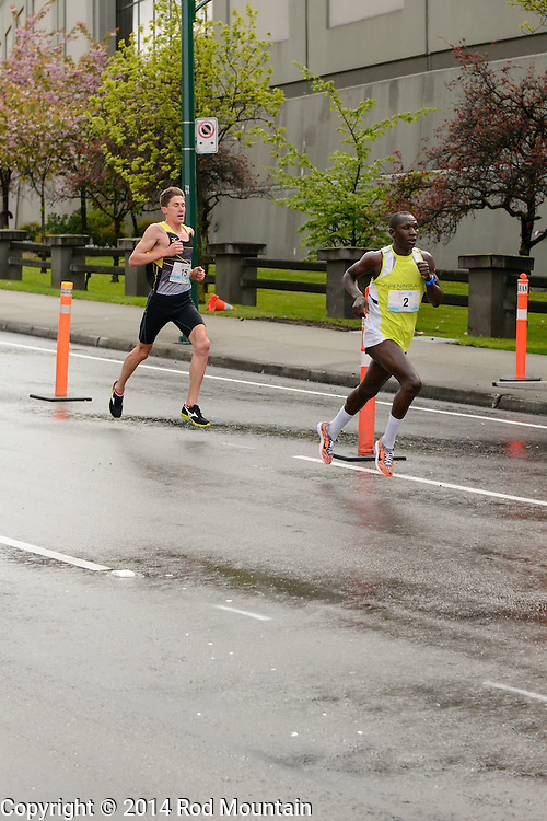 Paul Kimugul has placed first in the 2014 Sun Run followed closely by Dylan Wykes in 2nd place. Sunday, April 27, 2014 Vancouver, British Columbia
