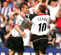 Photo: Daniel Hambury, Digitalsport<br /> Fulham v Everton.<br /> FA Barclays Premiership.<br /> 30/04/2005.<br /> Fulham's second goal scorer Brian McBride celebrates with Lee Clarke.