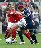 Photo: Dave Linney.<br />Nottingham Forest v Bournemouth. Coca Cola League 1. 29/04/2006Forest's.Nicky Southall (L) keeps an eye on the ball despite the attention of Callum Hart