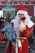 Moscow, Russia, 06/01/2006..Russians celebrate the lengthy New Year and Orthodox Christmas holidays. Street photographer dressed as Ded Moroz [Father Frost] , the Russian version of Santa Claus, with monkey.