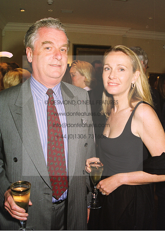 SIR TIM & LADY BELL at a party in London on 10th June 1998.MIF 26