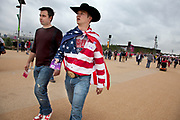 London 2012 Olympic Park in Stratford, East London. Fans of Team USA are abundant at the park. Wearing stars and stripes, the flag of America is a common sight. This fan going one further with the cowboy look.