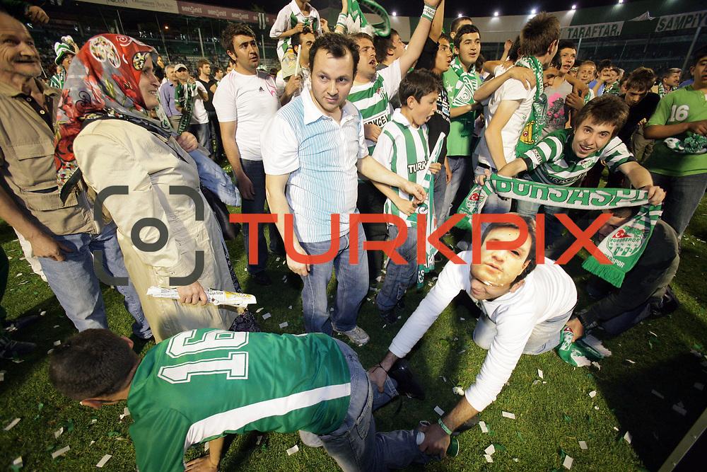 Bursaspor supporters celebrate their championship after their match against Besiktas at Ataturk Stadium in Bursa, Turkey, 16 May 2010.