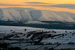 © Licensed to London News Pictures. 31/12/2020. Painscastle, Powys, Wales, UK.A wintry landscape view toward the Black Mountains range in the Brecon Beacons National Park from high land near Painscastle in Powys, Wales, UK. after temperatures plunged to around minus 3.5 degrees centigrade last night. Photo credit: Graham M. Lawrence/LNP