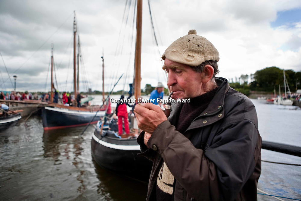 """Paddy Dundass,Kilkeerin,Connemara takes a break after unloading the turf from """"Capall"""" the oldest boat taking part in the Crinniú na mBad,Kinvara,Co Galway at the weekend. Photograph by Eamon Ward"""