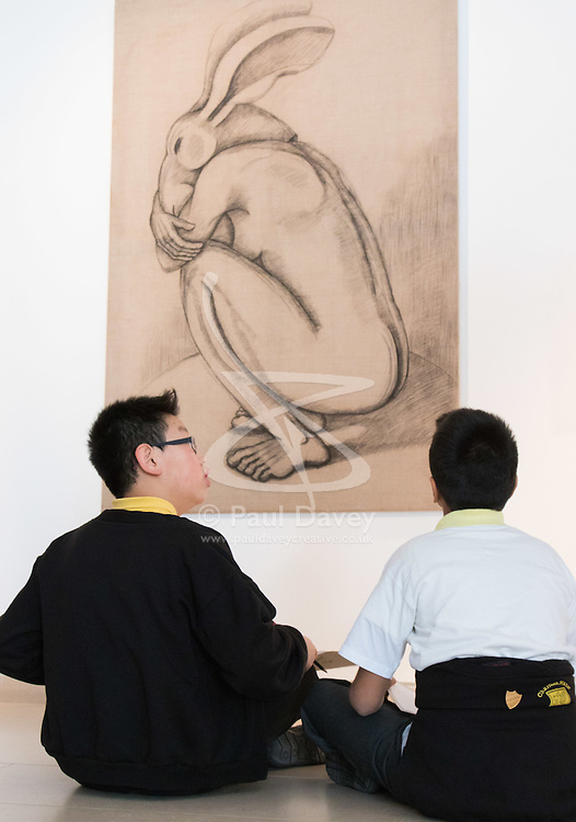 "Christies, St James, London, March 4th 2016. Two boys from Charlton Manor Primary School draw Sophie Ryder's charcoal on Linen ""Crouching Figure"", 2006, at the preview for the It's Our World charity auction at Christie's. Over 40 leading artists including David Hockney, Sir Antony Gormley, David Nash, Sir Peter Blake, Yinka Shonibare, Sir Quentin Blake, Emily Young and Maggi Hambling have committed artworks to the It's Our World Auction in support of The Big Draw and Jupiter Artland Foundation, to be sold at Christie's London on 10 March 2016.<br />  ///FOR LICENCING CONTACT: paul@pauldaveycreative.co.uk TEL:+44 (0) 7966 016 296 or +44 (0) 20 8969 6875. ©2015 Paul R Davey. All rights reserved."