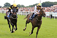 ESCOBAR (1) ridden by Jamie Spencer and trained by David O'Meara winning The John Smiths Racing Stables Handicap Stakes over 1m (£25,000) during the John Smiths Diamond Cup Meeting at York Racecourse, York, United Kingdom on 13 July 2019.