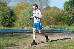 ©Licensed to London News Pictures 21/04/2020  <br /> Sidcup, UK.  A sunny morning run for this young man at Foots Cray Meadows in Sidcup, South East London as people get out of the house from coronavirus lockdown to exercise. Photo credit:Grant Falvey/LNP