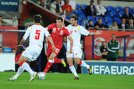 Gareth Bale of Wales in action.  Euro 2012 Qualifying match, Wales v Montenegro at the Cardiff City Stadium in Cardiff  on Friday 2nd Sept 2011. Pic By  Andrew Orchard, Andrew Orchard sports photography,