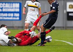 Dumbarton's goalkeeper Jamie Ewings saves at the feet of Falkirk's Phil Roberts.<br /> Dumbarton 1 v 1 Falkirk, Scottish Championship 10/8/2013.<br /> ©Michael Schofield.