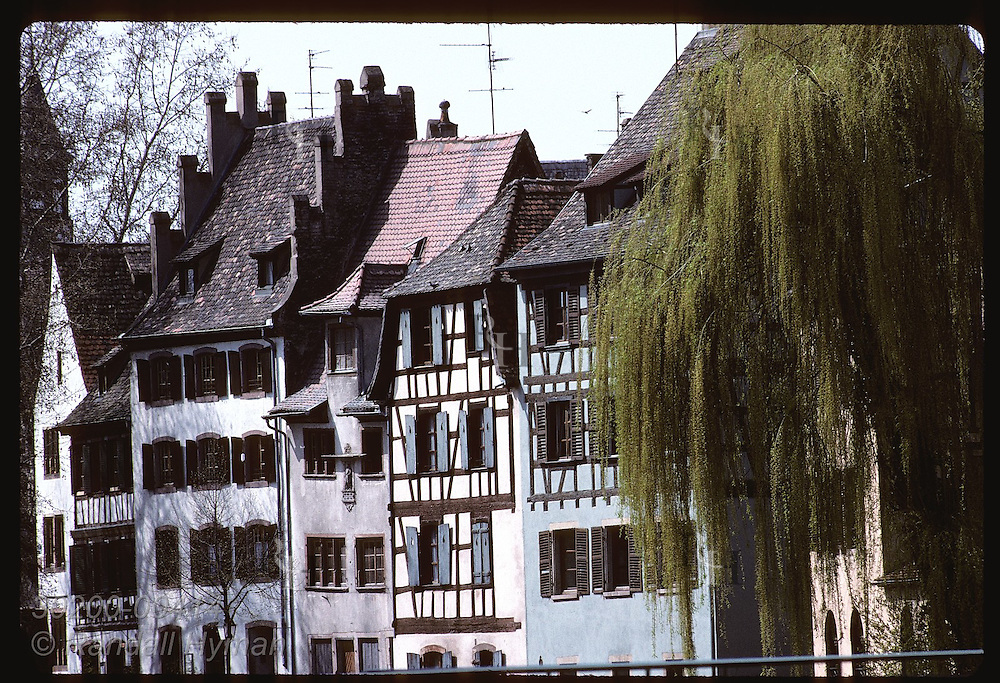 Row of old buildings with timbers embedded in facades is typical of Alsatian style; Strasbourg. France