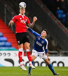 Bristol City's Aden Flint rises above Oldham Athletic's Rhys Turner to win a header - Photo mandatory by-line: Matt McNulty/JMP - Mobile: 07966 386802 - 03/04/2015 - SPORT - Football - Oldham - Boundary Park - Oldham Athletic v Bristol City - Sky Bet League One
