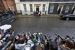 © Licensed to London News Pictures. 08/03/2017. London, UK. The Chancellor of The Exchequer Philip Hammond holds up the red dispatch box outside 11 Downing Street before heading to Parliament to deliver his Spring Budget.  Photo credit: Rob Pinney/LNP