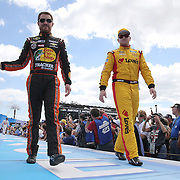 Race car drivers Ty Dillon (L) and Chris Buescher are seen during driver introductions prior to the 58th Annual NASCAR Daytona 500 auto race at Daytona International Speedway on Sunday, February 21, 2016 in Daytona Beach, Florida.  (Alex Menendez via AP)