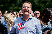 """A protester shouts at US President Donald Trump as he speaks during a """"Celebration of America"""" on the South Lawn of the White House on June 5, 2018 in Washington, DC. The celebration is being staged as a replacement for a White House visit by the Super Bowl champion Philadelphia Eagles. Some of the team was planning on boycotting the event due to the President's stance on players kneeling during the National Anthem at NFL games, so Trump resented their invitation.      Photo by Pete Marovich/UPI"""