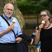 People eating ice-cream at Green Park, London, UK on July 19 2018.