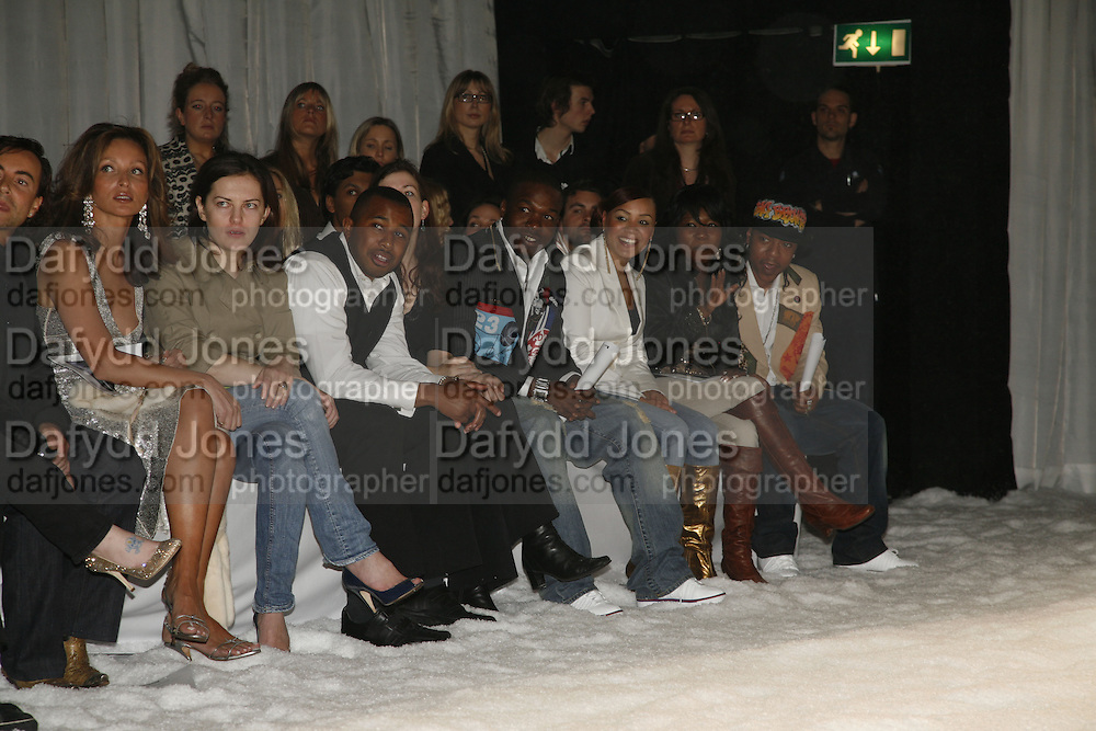 Randy, Cherise, Nadia and  J Rock. DENIS SIMACHEV SHOWCASES AUTUMN/WINTER 06 MENSWEAR & WOMENSWEAR COLLECTIONS<br />AT CHELSEA FOOTBALL CLUB. Supported by Vogue Russia<br />11 April 2006. ONE TIME USE ONLY - DO NOT ARCHIVE  © Copyright Photograph by Dafydd Jones 66 Stockwell Park Rd. London SW9 0DA Tel 020 7733 0108 www.dafjones.com