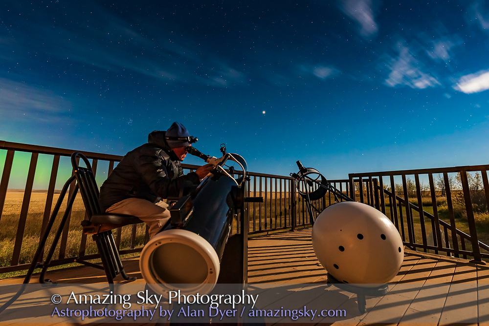 A selfie observing Mars with the two Dobsonian telesscopes: the 8-inch Sky-Watcher Flextube and the unique 12.5-inch MAG1 Portaball, to compare views. This was September 27, 2020.  A diffuse aurora is at left to the northeast.  Illumination is from the waxing gibbous Moon off camera to the right. <br /> <br /> A single exposure with the Nikon D750 and Sigma 14mm Art lens.