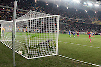 Steaua Bucharest's Raul Rusescu (R) scores from 11m kick during the first leg of the UEFA Europa League round of 16 football match between Steaua Bucharest and Chelsea at the National Arena Stadium in Bucharest on March 7, 2013.