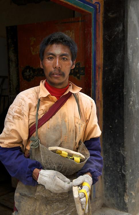 Tibetan pilgrim, Jokhang Temple, Barkhor, Lhasa, Tibet