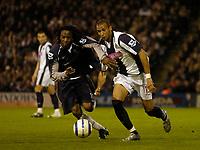 Photo: Glyn Thomas.<br />West Bromwich Albion v Bolton Wanderers. The Barclays Premiership. 17/04/2006.<br /> West Brom's Nigel Quashie (R) is tackled by Jay-Jay Okocha.