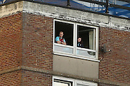 West Ham United fans watch the match from this flat overlooking the ground.. The Emirates FA cup, 6th round replay match, West Ham Utd v Manchester Utd at the Boleyn Ground, Upton Park  in London on Wednesday 13th April 2016.<br /> pic by John Patrick Fletcher, Andrew Orchard sports photography.