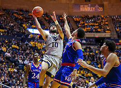Jan 19, 2019; Morgantown, WV, USA; West Virginia Mountaineers guard Jermaine Haley (10) shoots during the second half against the Kansas Jayhawks at WVU Coliseum. Mandatory Credit: Ben Queen-USA TODAY Sports