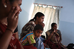 Sisters Manjula Pandya, 30, Pushpa Pandya, 27, and Gauri Pandya, 29, gather with their children at Anand's Kaival Hospital in Anand, India on April 14, 2007. Pushpa was the first successful surrogate at the clinic. Manjual and Gauri are Pushpa's sisters-in-law, and became involved after seeing her success. Dr. Nayna Patel, director of Anand's Kaival Hospital, currently has more than 25 women who have been implanted with embryos at her clinic. A few have already gone through the process once and are eager for a second go-round. While Patel claims many of the women do this for altruistic reasons, she acknowledges that money was the primary reason these women had queued up to be surrogates; without it, the list would be short, if not nonexistent. Payment usually ranges from about $2,800 to $5,600, a fortune in a country where annual per capita income hovers around $500.