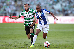 May 25, 2019 - Oeiras, Portugal - OEIRAS, PORTUGAL - MAY 25: Porto's Algerian forward Yacine Brahimi (R ) vies with Sporting's defender Jefferson from Brazil during the Portugal Cup Final football match Sporting CP vs FC Porto at Jamor stadium, on May 25, 2019, in Oeiras, outskirts of Lisbon, Portugal. (Credit Image: © Pedro Fiuza/NurPhoto via ZUMA Press)