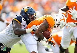 Sep 1, 2018; Charlotte, NC, USA; West Virginia Mountaineers defensive lineman Kenny Bigelow Jr. (40) tackles Tennessee Volunteers running back Tim Jordan (9) during the first quarter at Bank of America Stadium. Mandatory Credit: Ben Queen-USA TODAY Sports