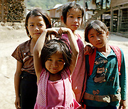 Four Akha Pouli ethnic minority girls in the village of Ban Huayana Khang, Luang Namtha province, Lao PDR