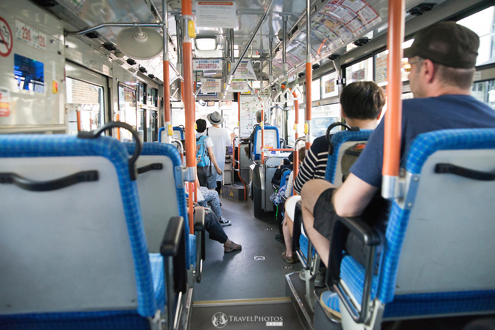Inside the city bus commonly used by tourists in Kyoto, Japan.