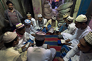 Moslem boys at prayer class in the muslim neighborhood around the Nakhoda Mosque is a labyrinth of bazars and winding alleyways.