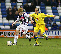 Photo: Mark Stephenson.<br />West Bromwich Albion v Leeds United. The FA Cup. 06/01/2007.<br />West Brom's goal scorer Paul McShane  (L) is tackled by Leed's Eddie Lewis.